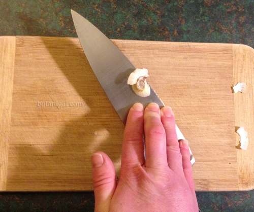 Pressing garlic clove with knife blade IMG_3389.jpg